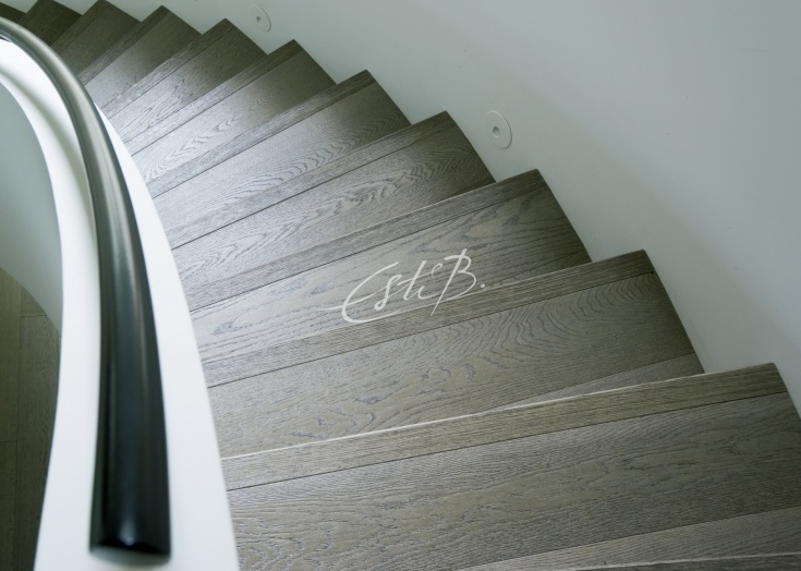 Driftwood oak boards on a curved staircase