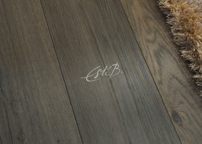 Close-up of fumed oak wood floor with brown rug