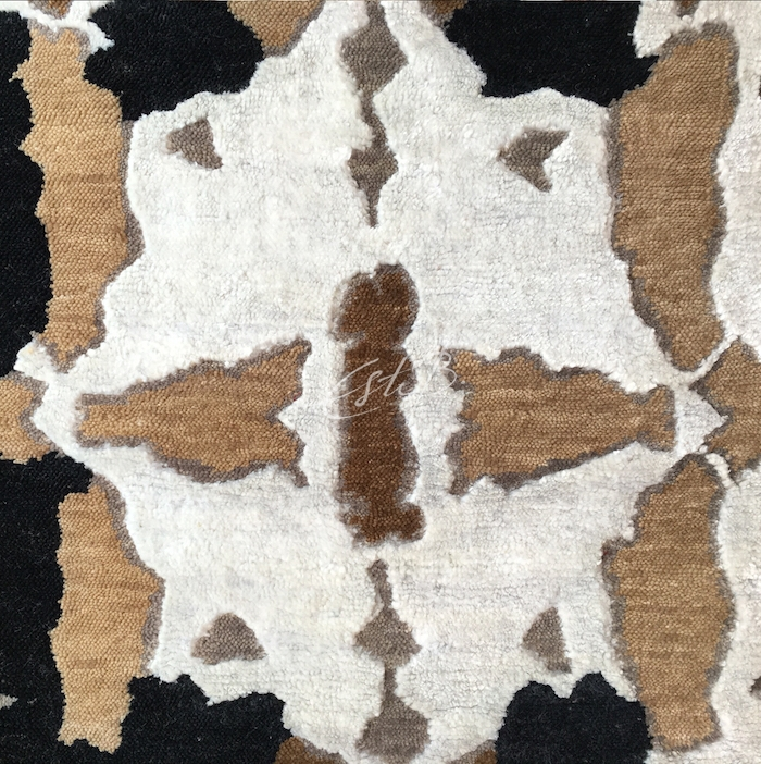The repeating pattern of Ebony and Ivory rug - looks like stylised cowhide
