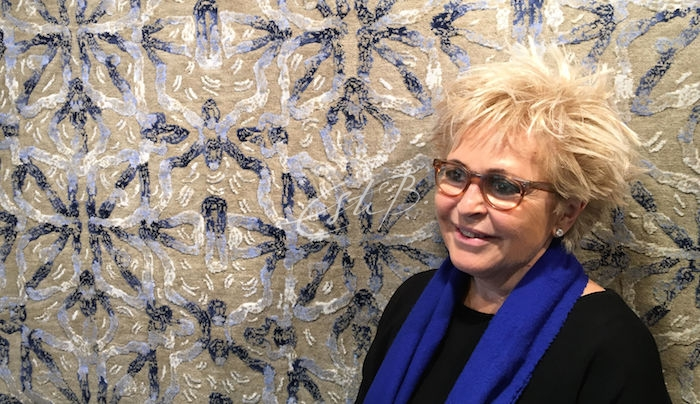 Esti Barnes in front of Brocade rug in the Topfloor showroom